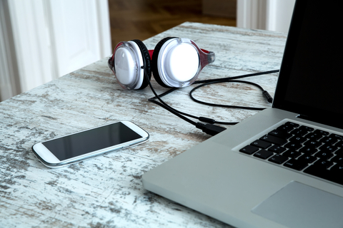 Headphones and a laptop computer on a desktop