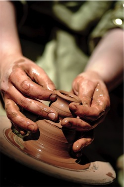 Potter making a clay pot (iStockPhoto)